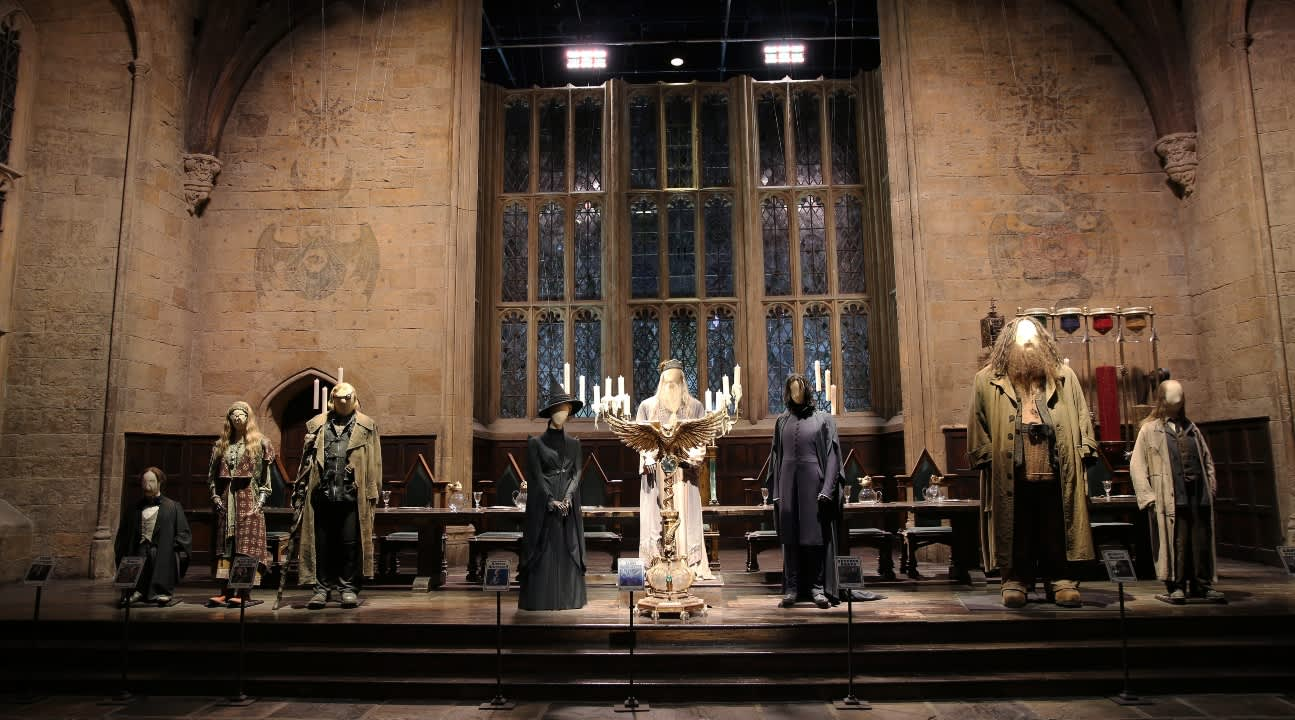 the Great Hall with costumers of the Hogwarts professors